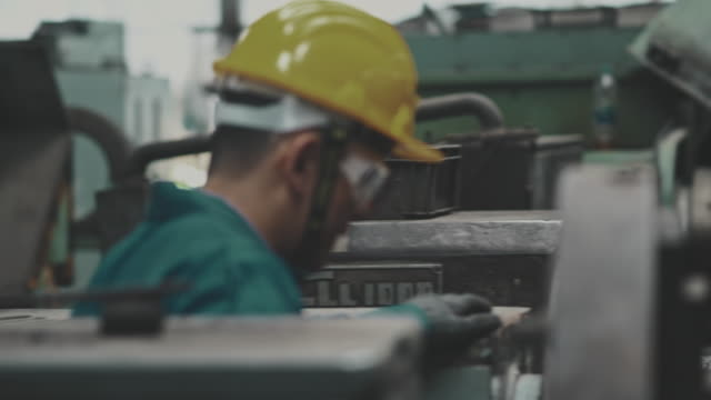 factory worker with safety hard - behind stock videos & royalty-free footage