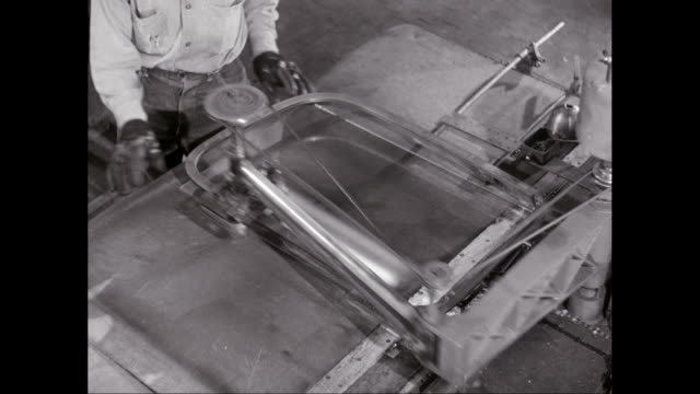 cu factory worker working on machinery in factory / united states - material stock videos and b-roll footage