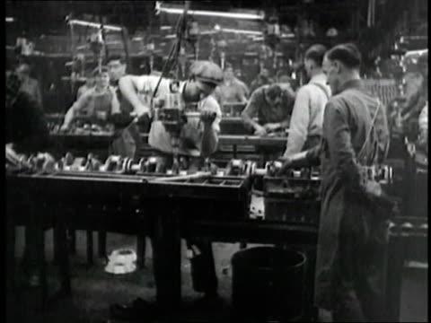 vídeos y material grabado en eventos de stock de factory workers assemble parts. - 1930 1939