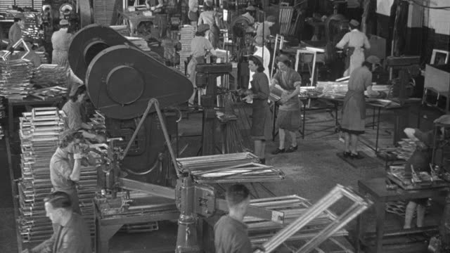 1947 montage factory workers assembling and installing windows and window frames / united kingdom - 1947 stock videos & royalty-free footage