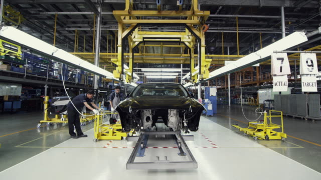 ws factory workers assembling car on production line / samut prakan, bang muang mai, thailand - car plant stock videos and b-roll footage