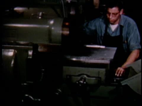 vídeos y material grabado en eventos de stock de 1951 montage factory workers at work / detroit, michigan, united states - 1951