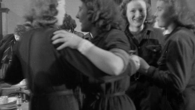 montage factory workers dancing and then exiting cafeteria as lunch break ends / united kingdom - 1942 stock videos & royalty-free footage