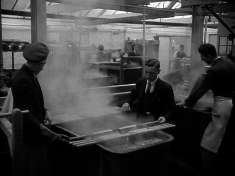 factory workers dye silk in large vats which will be woven into velvet for the coronation robe for elizabeth the second 1953 - 1953 stock videos and b-roll footage