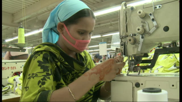 factory workers in textile factory in bangladesh - bangladesh stock videos & royalty-free footage