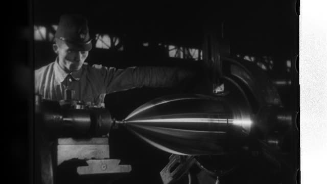 factory workers make bombs at a turnery, assemble anti-aircraft-guns by grinding down cannon barrels, stuff gunpowder in airframes, and put together... - gunpowder explosive material stock videos & royalty-free footage