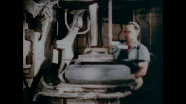 1947 factory workers make tires, foundry workers cast iron and steel and machinery and lathes make new products - steel stock videos & royalty-free footage