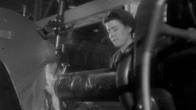 montage factory workers operating machinery in factory / united kingdom - anno 1942 video stock e b–roll