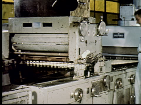 ms, composite, cu, factory workers overseeing cookies production on conveyer belt in factory, usa - biscuit stock videos & royalty-free footage