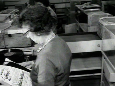 factory workers place newly pressed gramophone records into their sleeves at a record factory. - 1950 1959 stock videos & royalty-free footage