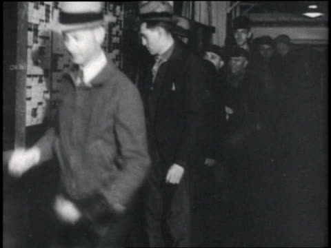 factory workers punch their time cards on time clocks - 1930 stock videos & royalty-free footage
