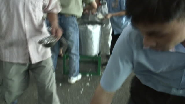 MS TD Factory workers scooping rice into bowls from large pot/ Dongguan, China