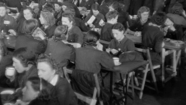 vidéos et rushes de 1942 montage factory workers singing and dancing during lunch break / united kingdom - 1942
