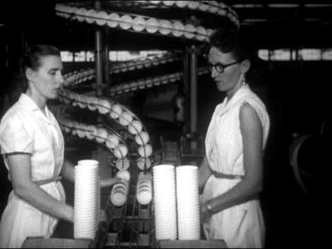 factory workers stacking paper cups coming off conveyor belt at lily-tulip cup corporation / augusta, georgia / audio - disposable stock videos and b-roll footage