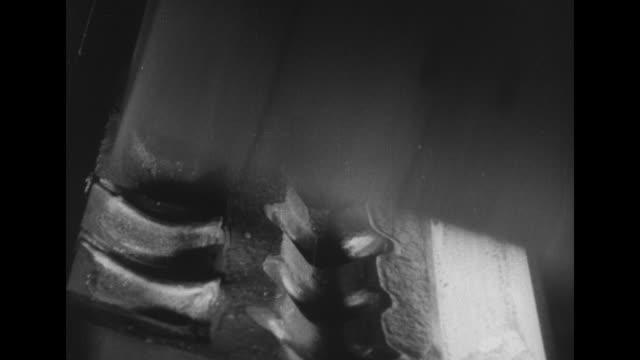 vídeos y material grabado en eventos de stock de factory workers throwing scrap metal and shoveling coal into furnace / molten steel pouring out of furnace into vat / molten steel pouring out of vat... - sparks