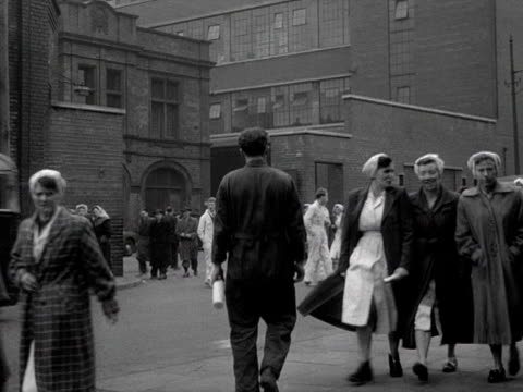 factory workers walk along a street in salford. - manufacturing occupation stock videos & royalty-free footage