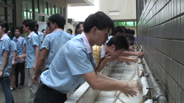 MS Factory workers wash up in sink before lunch/ Dongguan, China