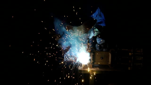 factory workers working at spot welding - car plant stock videos & royalty-free footage