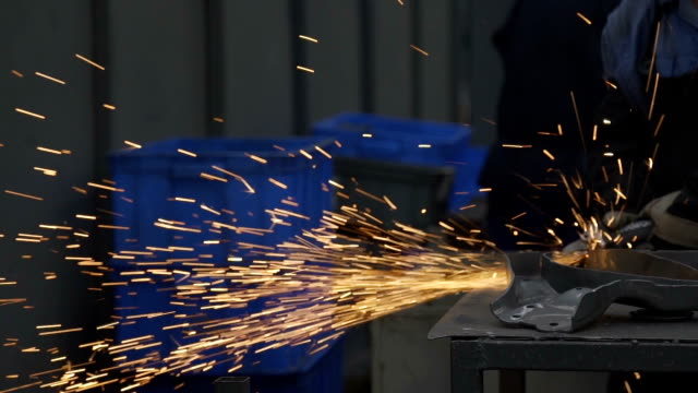 factory workers working at spot welding - sparks stock videos & royalty-free footage