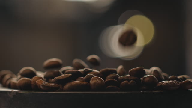 fade in shot of roasted coffee beans at factory - fade in stock videos & royalty-free footage