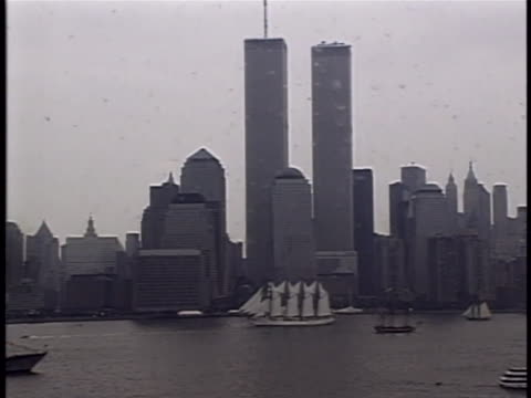 fade in shot to a zoom of multiple boats in the harbor sailing. fades into wide shot of multiple boats sailing in harbor with twin towers in the... - fade in video transition stock videos & royalty-free footage