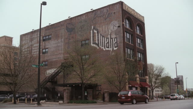faded advertisements are painted on the exterior of a loft apartment building in omaha. - omaha stock videos & royalty-free footage
