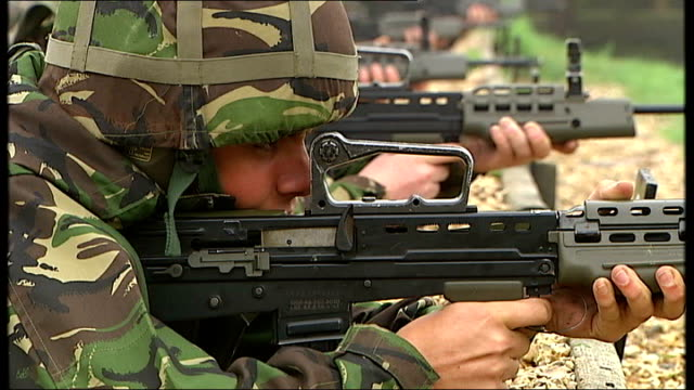 failed army recruitment system costs government 67 million pounds t16080912 / tx england cambridgeshire bassingbourn ext close up of gun barrel as... - military training stock videos and b-roll footage