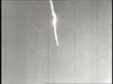 a failed german v2 rocket bomb blasts into the air and then explodes on the ground damaging nazi airplanes - lenkflugkörper stock-videos und b-roll-filmmaterial
