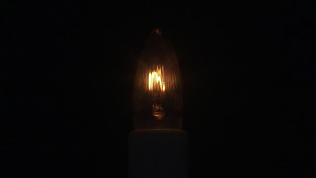 a faint christmas tree light. - electric light stock videos and b-roll footage