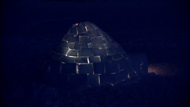 a faint glow shines from an igloo at night. available in hd. - igloo stock videos & royalty-free footage