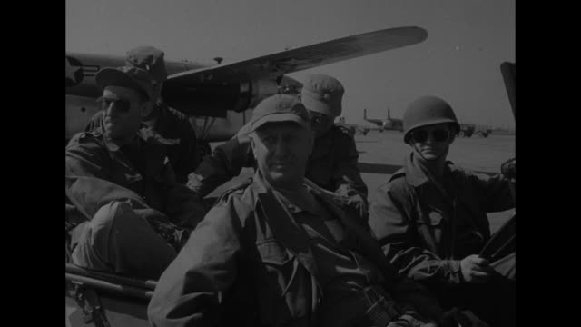"""fairchild c-119 """"flying boxcar"""" plane proceeds along runway after touching down at gimpo international airport / mws us troops open up boxcar plane... - cargo train stock videos & royalty-free footage"""