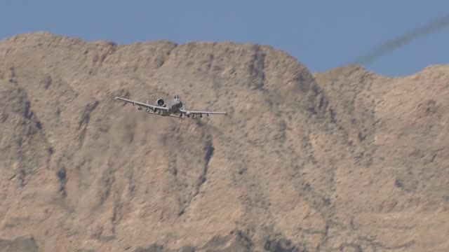fairchild republic a10 thunderbolt ii from the 422 tes firing guns and rockets on the nevada test and training range - gun stock videos & royalty-free footage