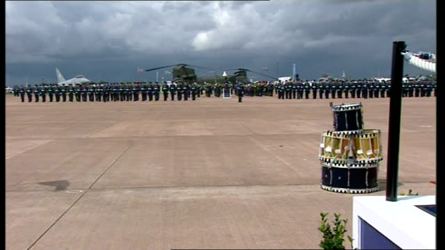 queen inspects parade / presents colours / makes speech more of band playing sot / more of parade - raf fairford stock videos and b-roll footage