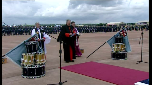 Queen inspects parade / presents Colours / makes speech More of religious service / Ministers away