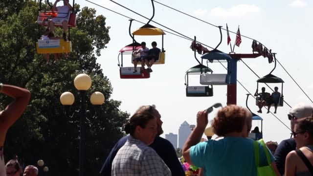 fairgoers ride the sky glider during the iowa state fair on august 16 2015 in des moines iowa the iowa state fair is one of the oldest and largest... - agricultural fair stock videos & royalty-free footage