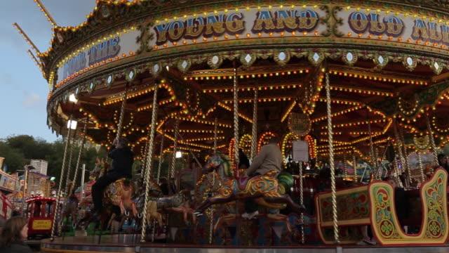 fairground ride, goose fair, nottingham, nottinghamshire, england, uk - roundabout stock videos & royalty-free footage