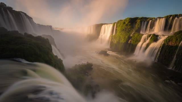 fairytale waterfall at sunrise, iguazu falls, brazil - unesco world heritage site stock videos & royalty-free footage