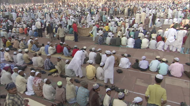 faithful muslims worship in front of the grand mosque in mecca as they participate in their hajj. - pilgrimage stock videos & royalty-free footage