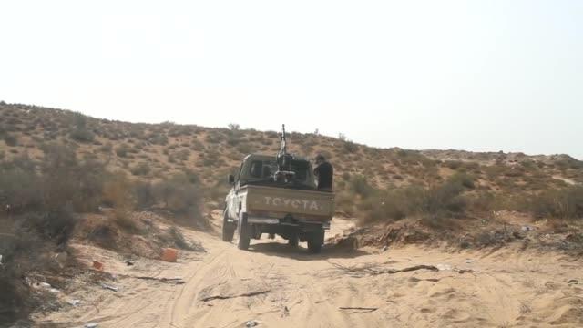 vídeos y material grabado en eventos de stock de fajr libya forces take up positions against armed groups in wershfana town located in 27 km west of tripoli libya on october 13 2014 - 2014