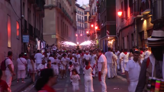 fake bulls with squibs and torches run during the san fermin festival in pamplona spain on july 6 2017 the san fermin festival is held annually from... - comunidad foral de navarra stock videos and b-roll footage