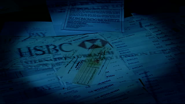 fake cheques seized in international fraud investigation graphicised seq computer / fraudulent cheques and fake bank letters reporter to camera with... - cheque financial item stock videos & royalty-free footage
