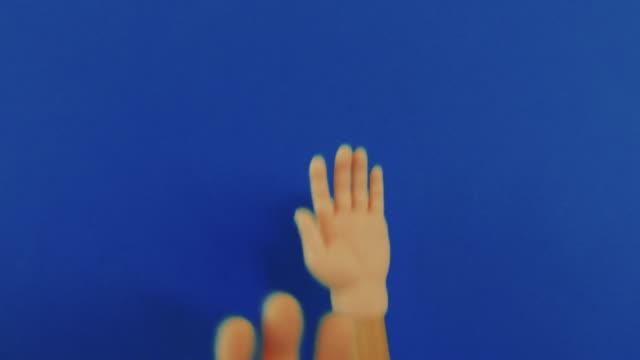 Fake Dancing Hands on Blue Backdrop