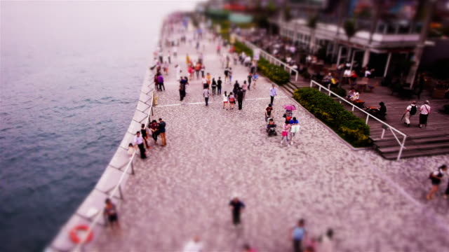 fake miniature shot of the avenue of the stars, hong kong - spoonfilm stock-videos und b-roll-filmmaterial