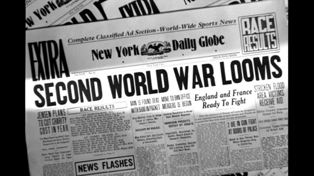 vídeos de stock, filmes e b-roll de second world war looms france fears nazi invasion fake newspaper headlines on january 01 1940 - primeira página de jornal