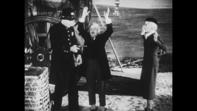 1933 fake policeman holds museum curator and daughter hostage, hiding them under a basket - curator stock videos & royalty-free footage