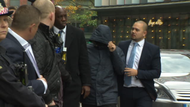 Fake Sheik' Mazher Mahmood walking into court with a hood covering his face