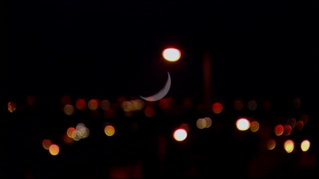 Falkirk Bonnybridge EXT / NIGHT **The XFiles theme tune music overlaid SOT** Moon in sky PULL Various of street lights in residental area