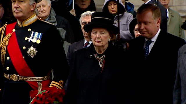 baroness thatcher lays wreath at memorial service baroness thatcher out of building with military dignitaries they stand in silence as bugler plays... - memorial event stock videos and b-roll footage