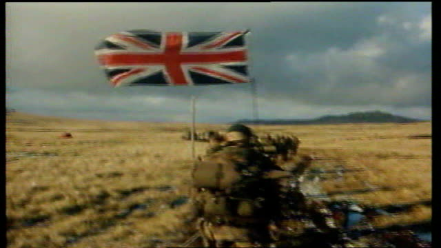 veterans revisit falklands to honour their fallen comrades tx 2661982 back view of british troops marching away as union jack flag attached to aerial... - marching stock videos and b-roll footage
