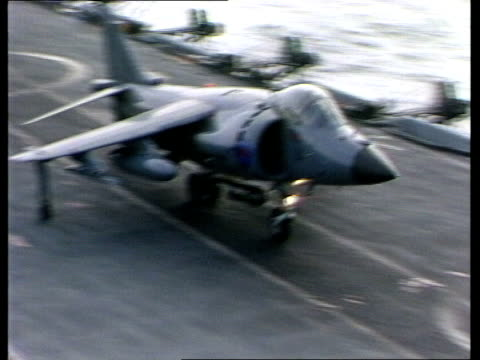hms sheffield at sea ts sea harrier off hms hermes ts another off ship/ zoom sea harrier towards air tx 17482 ship/ hovers zoom in air ship/ sea... - シェフィールド点の映像素材/bロール